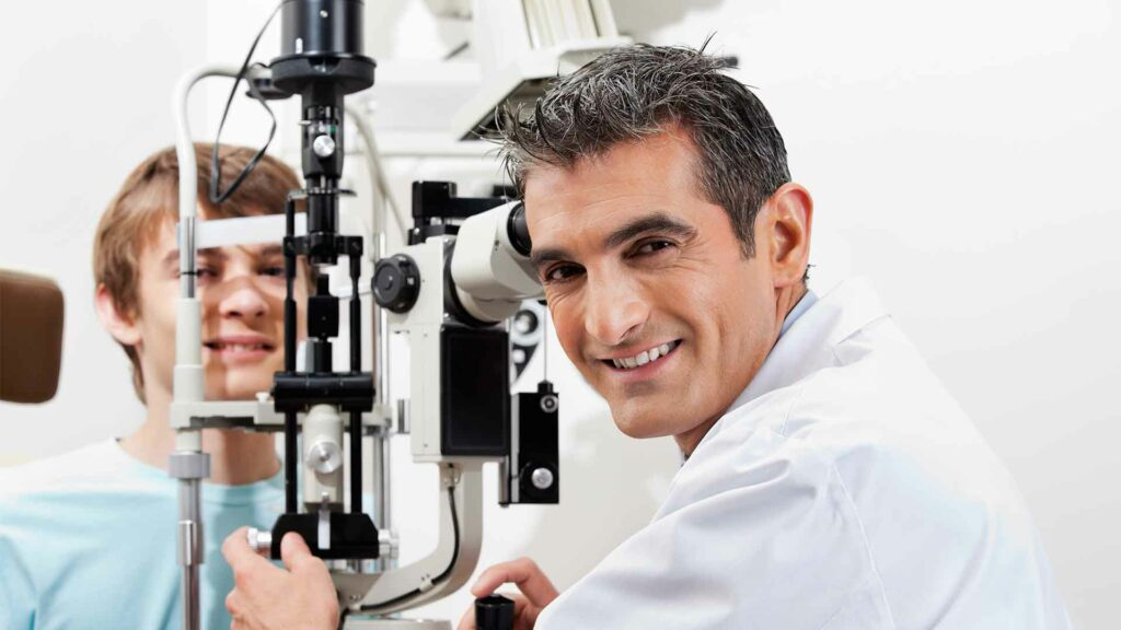 Optician and young patient